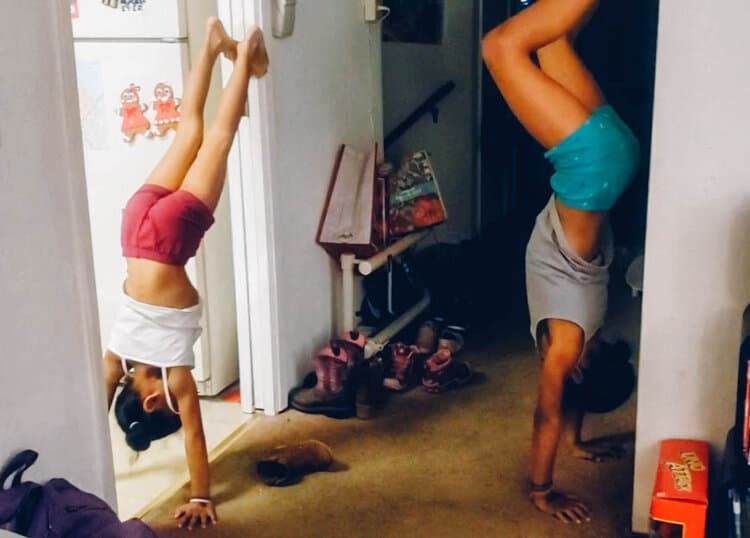 "Sisters Olivia and Phoenix, ""Wall Handstands""    Preschool/Youth Classes Taken:  AcroFitness, Parkour, Jr. Parkour  [Their mama @tbeta21]"